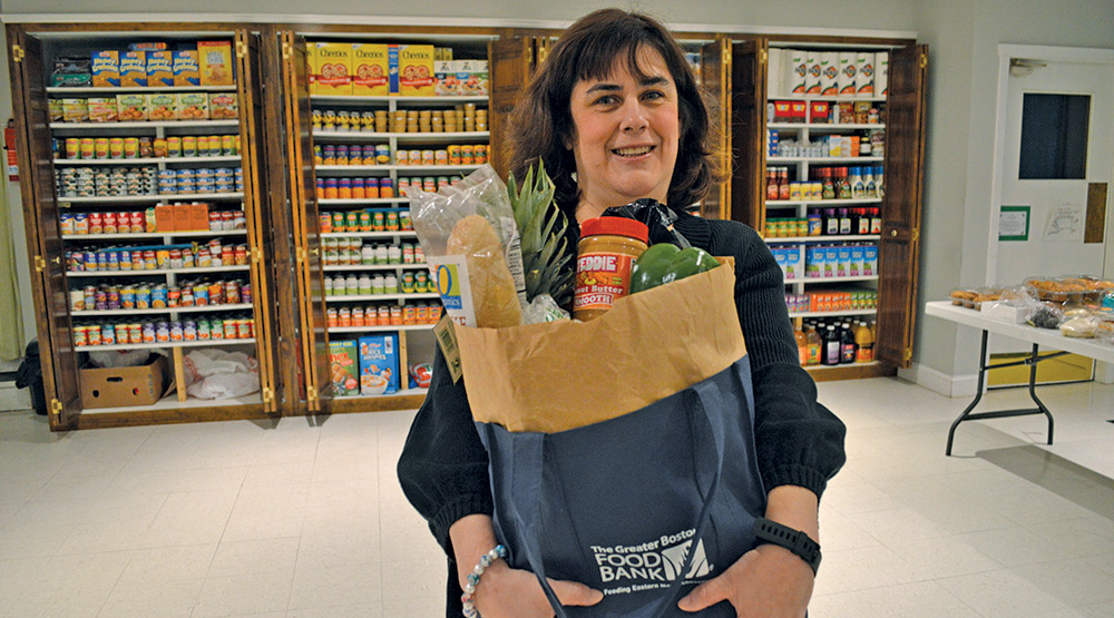 Kelly holding her bag of groceries