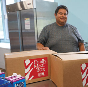 Pedro with GBFB's Family Meal Boxes