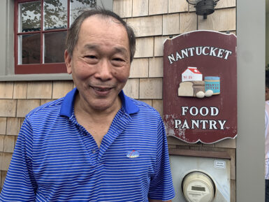 Nantucket food pantry client Chin M. smiling at the camera