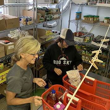 Nantucket Food Pantry volunteers packing food boxes for clients